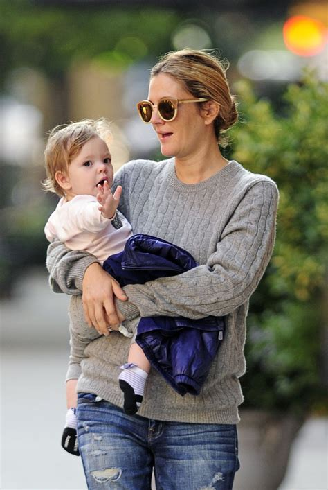 Drew Barrymore Photos - Drew Barrymore Carries Baby Olive