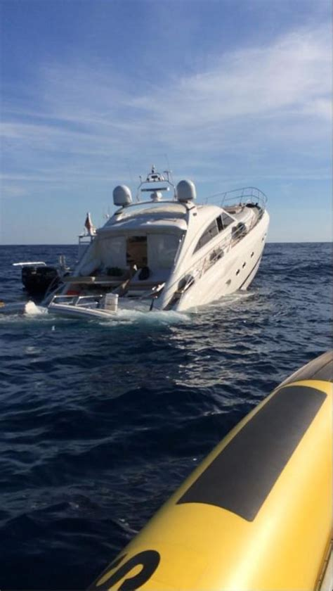 Crews tow sinking 63-foot yacht to shore; four rescued
